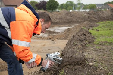 Analysing the soil with HXRF and taking samples, environmetal research.