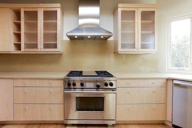 Stove and hood in modern kitchen