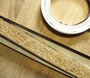 Chipboard. Plastic and paper edge wrapping of furniture.