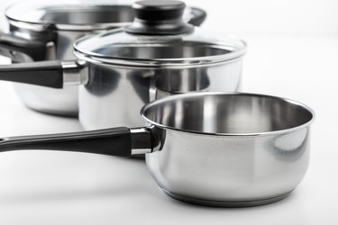 Aluminum pots and pans isolated on white