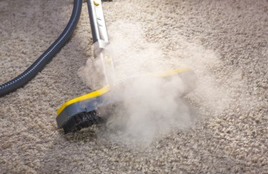 A steam cleaner in action cleaning a carpet