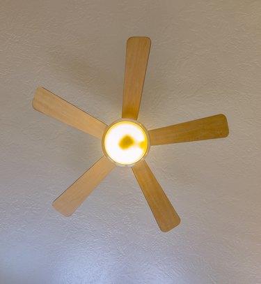Ceiling fan looking up in model home.