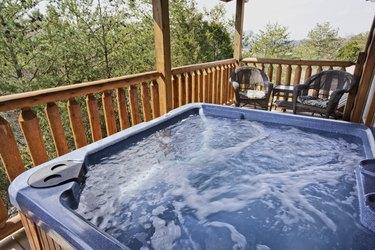 A empty running hot tub on the balcony