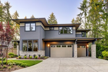New construction home with wood and stone siding