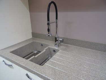 Stainless-steel kitchen sink / single basin, composite-laminate, corian grey worktop counter-top