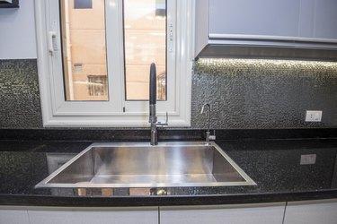 Modern kitchen sink in a luxury apartment