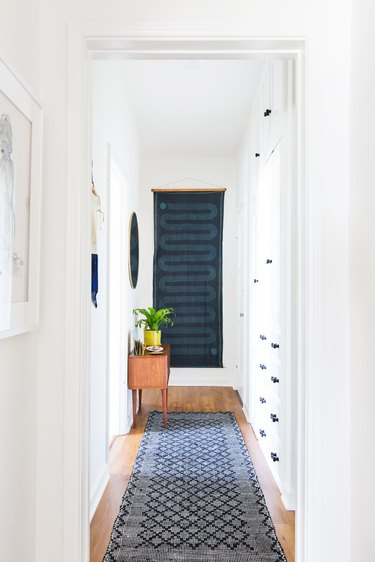 Small entryway with statement art by Emily Henderson Design