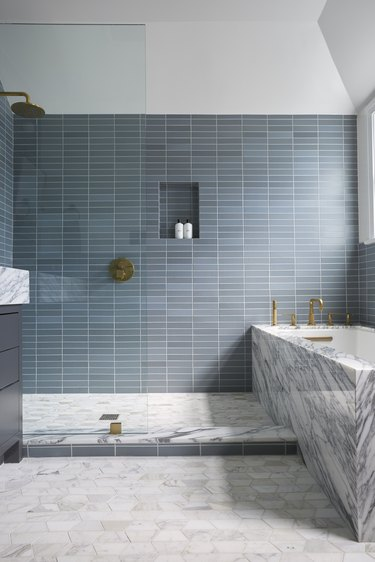walk-in shower with rain showerhead and blue-gray tile