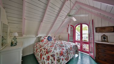 the pink house bedroom with paisley bedding