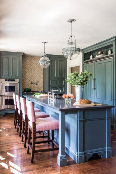 contemporary kitchen with blue Raised Panel Cabinetry