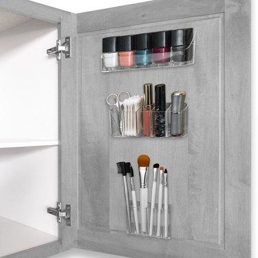 Medicine Cabinet Organization ideas in Small plastic bins on inside of medicine cabinet door.