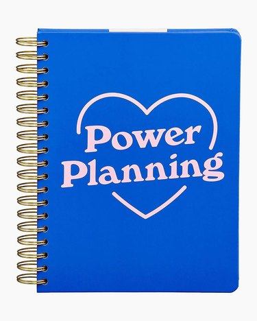 blue planner with pink heart and text