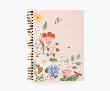 spiralbound planner with pink floral design