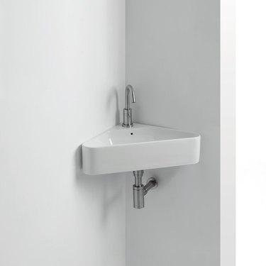 Modern minimalist white corner bathroom sink with linear details