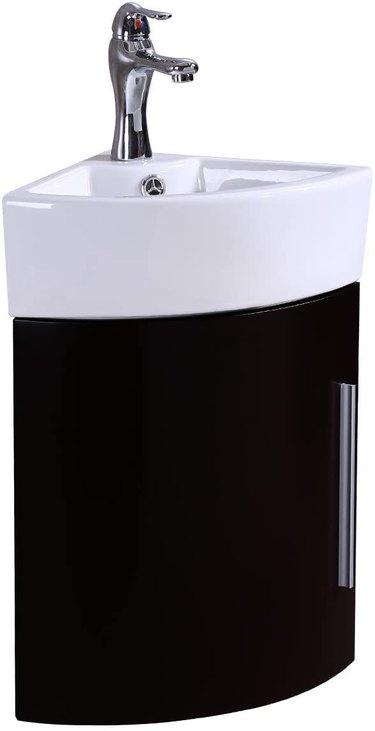 White porcelain wall mount corner bathroom sink with black cabinet