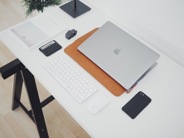 desk with computer, keyboard, phone and other desk tools