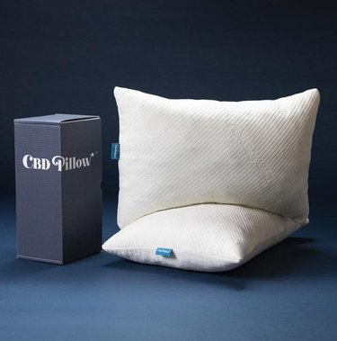 cardboard box and CBD pillows stacked