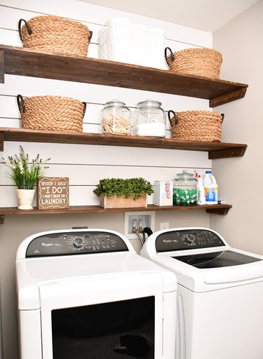 Budget-Friendly Small Laundry Room Ideas in laundry room with diy open shelving and shiplap walls