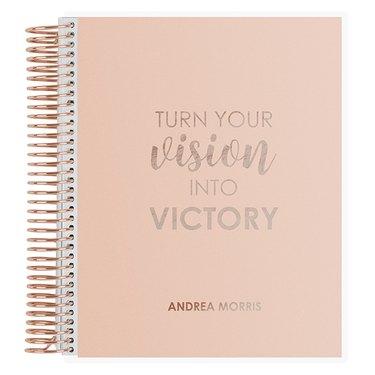 pink spiralbound journal with rose gold text