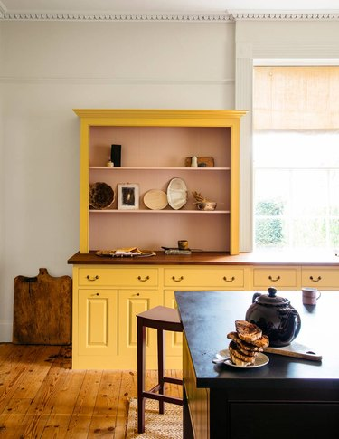 yellow and pink kitchen cabinet