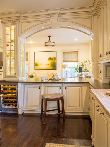 raised panel cabinetry and details in luxury white kitchen
