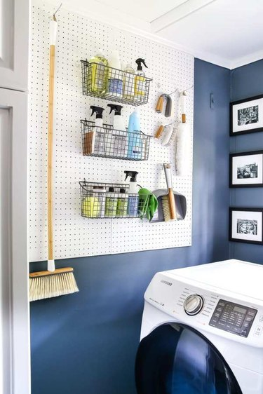 Budget-Friendly Small Laundry Room Ideas in navy blue laundry room with peg board