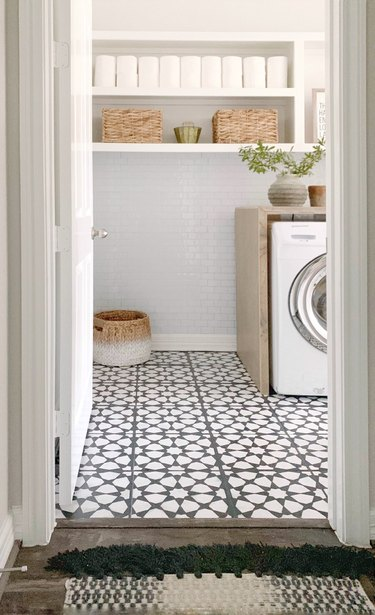 Budget-Friendly Small Laundry Room Ideas in black and white budget laundry room