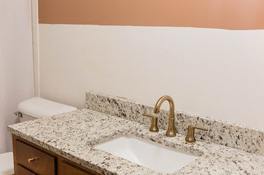 You should be left with an unblemished wall behind the wallpaper.