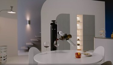 home with robot serving wine