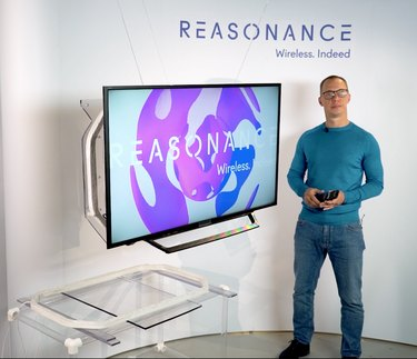 man standing near wireless television