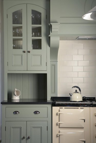 country kitchen with Raised Panel Cabinetry in muted green color