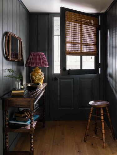 black shiplap hallway with wood floors