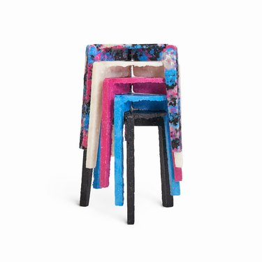 stack of stools in various colors