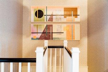 Hallway Wallpaper Ideas in hallway with rattan texture wallpaper and geometric artwork