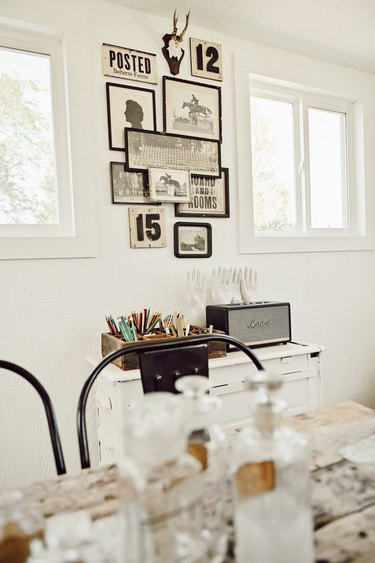 Farmhouse home office with vintage wall art and antique collections
