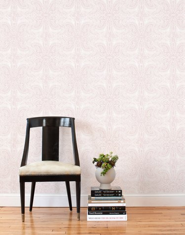 Hallway Wallpaper Ideas with blush pink wallpaper in hallway with retro chair