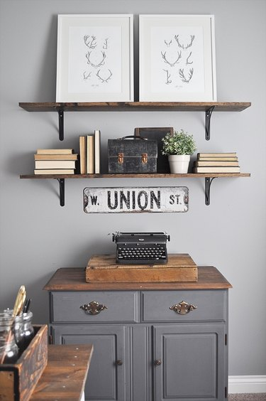 Farmhouse home office with vintage cabinet and rustic open shelving