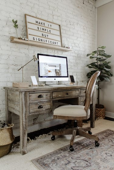 Farmhouse home office with rustic farmhouse desk and office chair