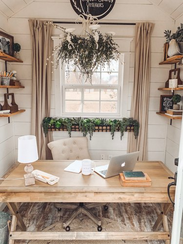 Farmhouse home office in neutral colors with wood desk and shelving