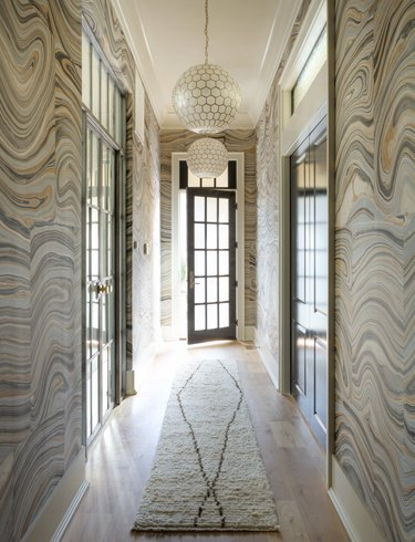 Hallway Wallpaper Ideas in foyer hallway with statement pink and gray agate pattern wallpaper