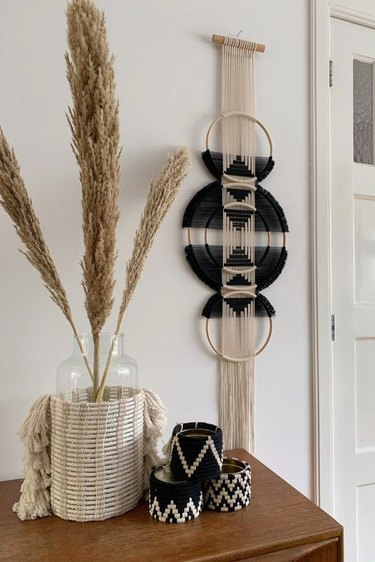 wall hanging near dried florals