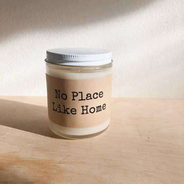 """candle with label that reads """"no place like home"""""""