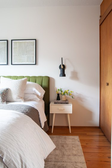 small guest room ideas with bedside table and wall lighting