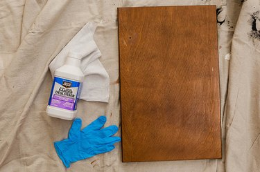 Use liquid sander deglosser to dull the finish on the doors and vanity surround.