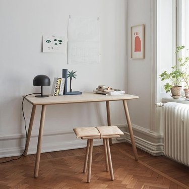 white Scandinavian home office with sleek desk and stool