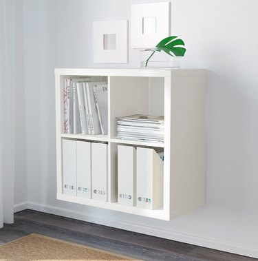 Bookshelves for Small Spaces with White bookcase, books, plant, art.