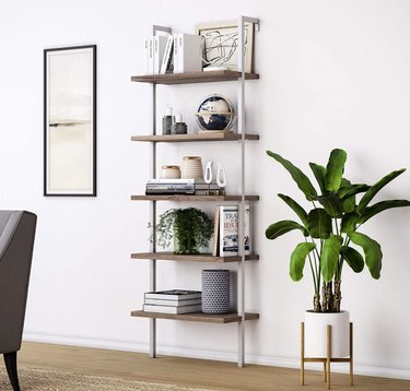Bookshelves for Small Spaces with plants, art, books, pottery.
