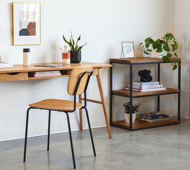 Bookshelves for Small Spaces with Desk, chair, bookcase, plant, books, concrete floor.