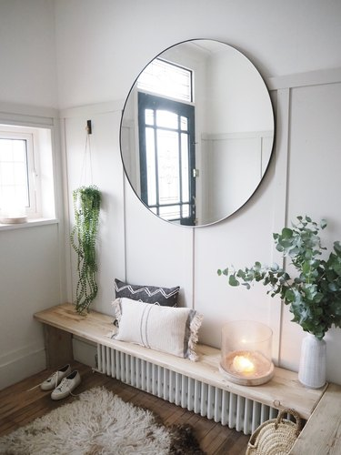 Hallway Makeover Ideas in gray paneled hallway with diy storage bench and large mirror