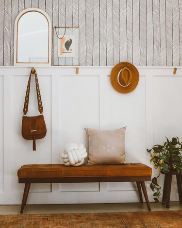 Hallway Makeover Ideas in boho hallway with coat hooks, bench and shelf